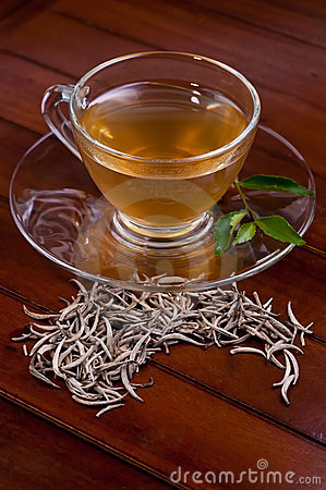 Silver tips tea on a wooden table