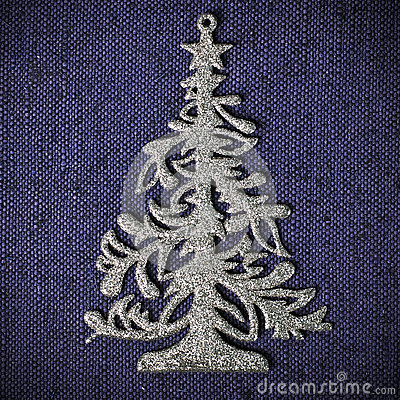 Silver xmas tree on blue canvas background
