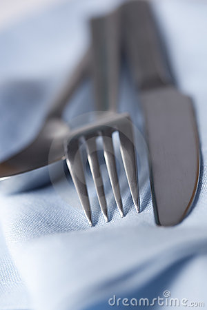 Silverware on Blue Napkin