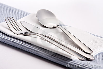 Silverware on tablecloth