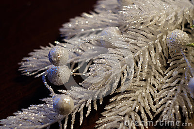 Silvery-white decorative Christmas branch