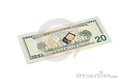 SIM cards for cellular phones on dollar bill