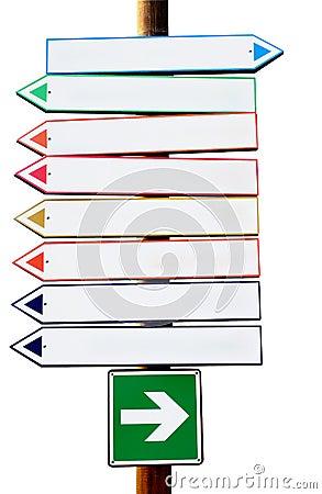 Sinais multicoloridos da seta direcional da estrada transversaa