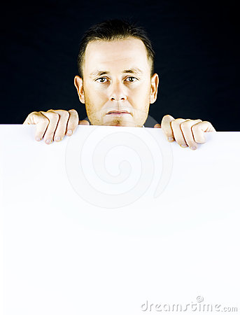 Sincere man holding blank banner