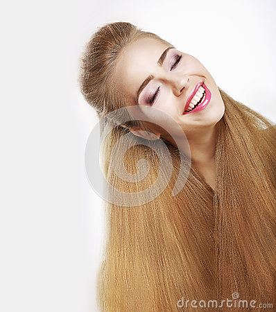 Sincere Smile. Jubilant Young Woman with Flowing Healthy Hairs. Pleasure