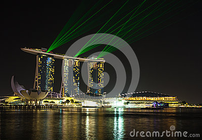 Singapore city at night with laser show