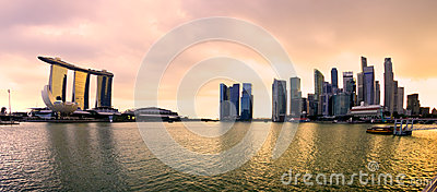 Singapore city skyline at sunset.
