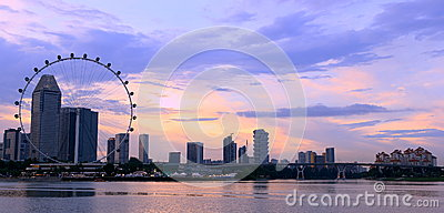 Singapore flyer and city in the sunset