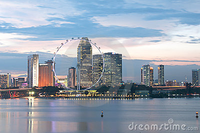 Singapore Flyer and Cityscape at dusk Editorial Photography