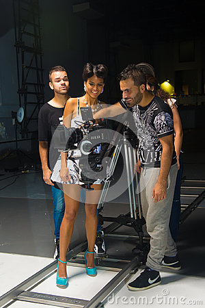 Free Singer And Crew Watching Camera Viewfinder, Filming Music Video Royalty Free Stock Photography - 98032007