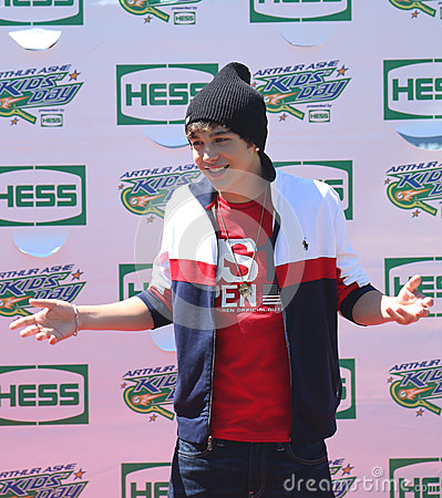 Singer Austin Mahone attends Arthur Ashe Kids Day 2013 at Billie Jean King National Tennis Center Editorial Stock Image