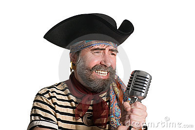 Singer pirate sings in an old microphone.