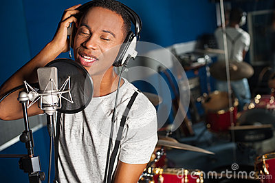 Singer recording a track in studio