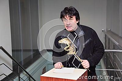 Singer A.Serov at Venetian costume masquerade Editorial Image