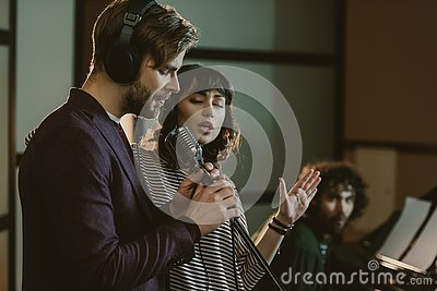 singers performing song while man Editorial Stock Photo
