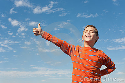 Singing happy boy in front of the sky