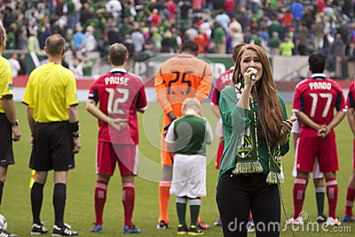 Singing the national anthem Editorial Stock Image