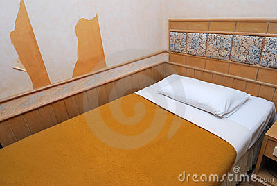 Single bed in old hotel room