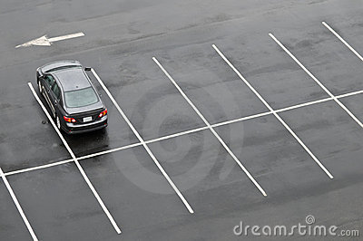 Single car in empty parking lot