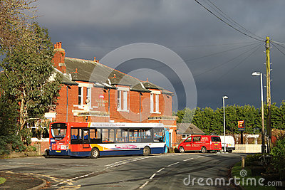Single deck bus at stop outside village pub. Editorial Stock Photo