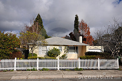 Single family house one story with picket fence