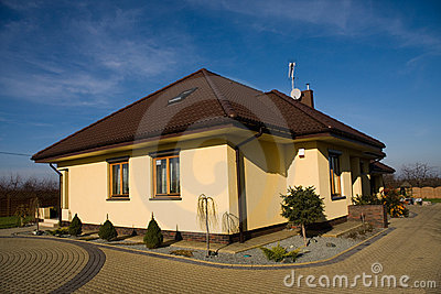 Single family yellow house