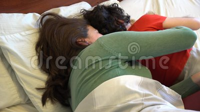 single mother and son sleeping together stock footage