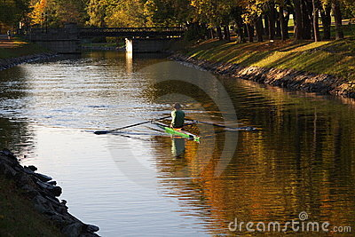 Single rower in a canal