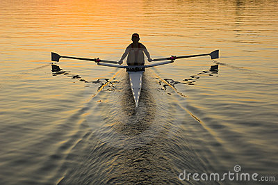 Single rower at sunrise