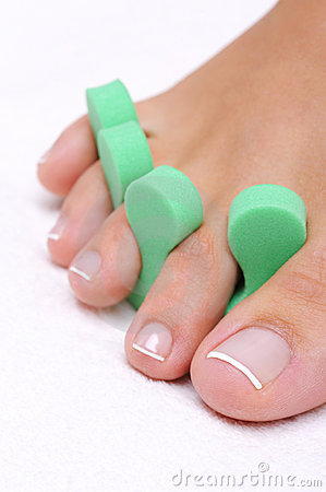 Single  woman foot with pedicure tool