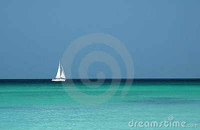 Single yacht sailing in tropical seas