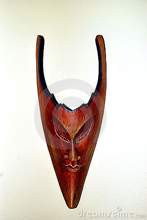 Sinister wooden mask with horns