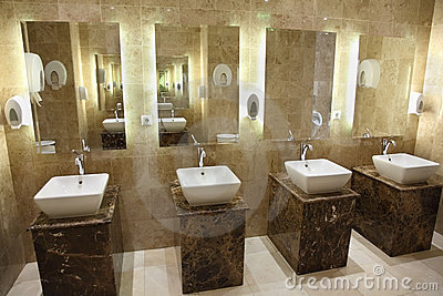 Sinks and mirrors in public restrooms