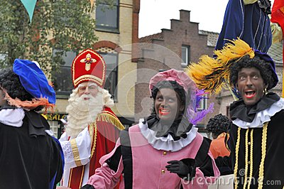 Sinterklaas arriving on his Steamboat with his black helpers (Zw Editorial Image