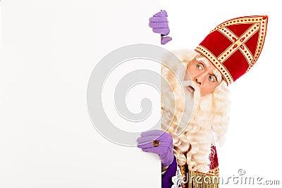 Sinterklaas looking on advertisement