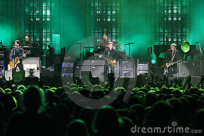 Sir Paul McCartney performs onstage at Olimpiyskiy Editorial Stock Photo