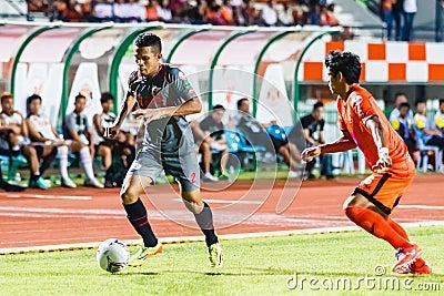 SISAKET THAILAND-JUNE 29: Ekkachai Sumrei of Bangkok Utd. (grey) Editorial Image