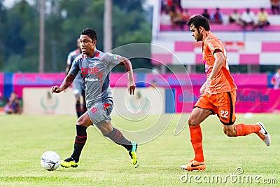 SISAKET THAILAND-JUNE 29: Leandro Tatu of Bangkok Utd. (grey) Editorial Stock Photo