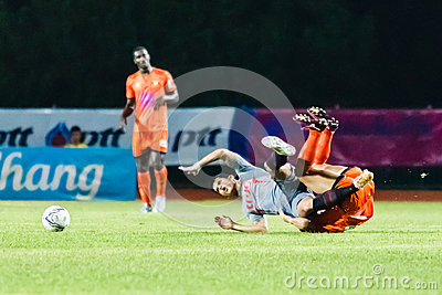 SISAKET THAILAND-JUNE 29: Mika Chunuonsee of Bangkok Utd. (grey) Editorial Stock Image