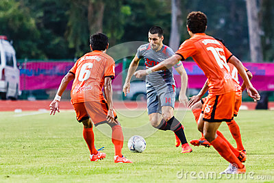SISAKET THAILAND-JUNE 29: Romain Gasmi of Bangkok Utd. (grey) Editorial Stock Image