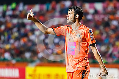 SISAKET THAILAND-JUNE 29: Victor Amaro of Sisaket FC. (orange) Editorial Stock Photo