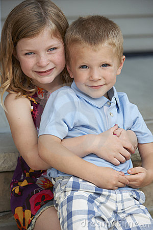 Sister And Brother Hugging