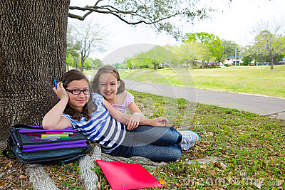 Sister firends girls relaxed under tree park after school