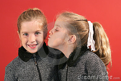 Sister giving a kiss
