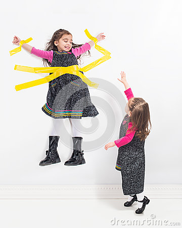 Free Sister Taped To Wall Stock Images - 39854144