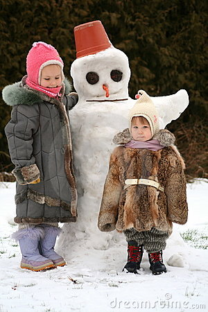 Free Sisters And The Snow-man Stock Image - 4053791