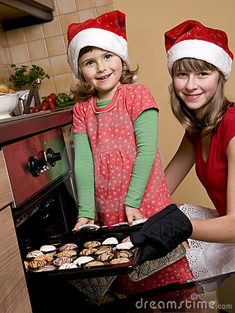 Sisters baking christmas cookies