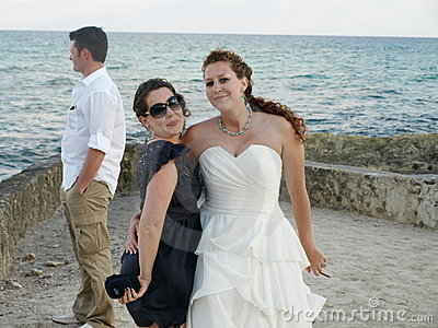 Sisters at beach wedding