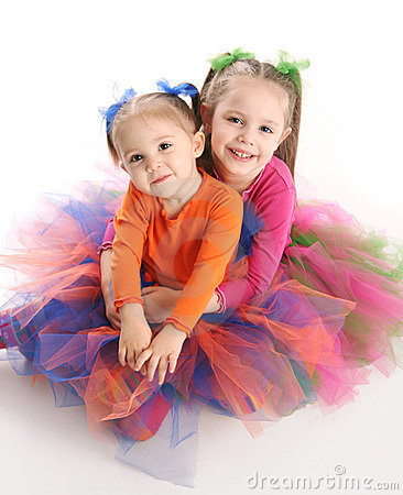 Sisters in bright tutu skirts