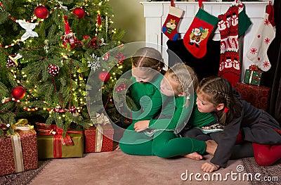 Sisters at the christmas tree